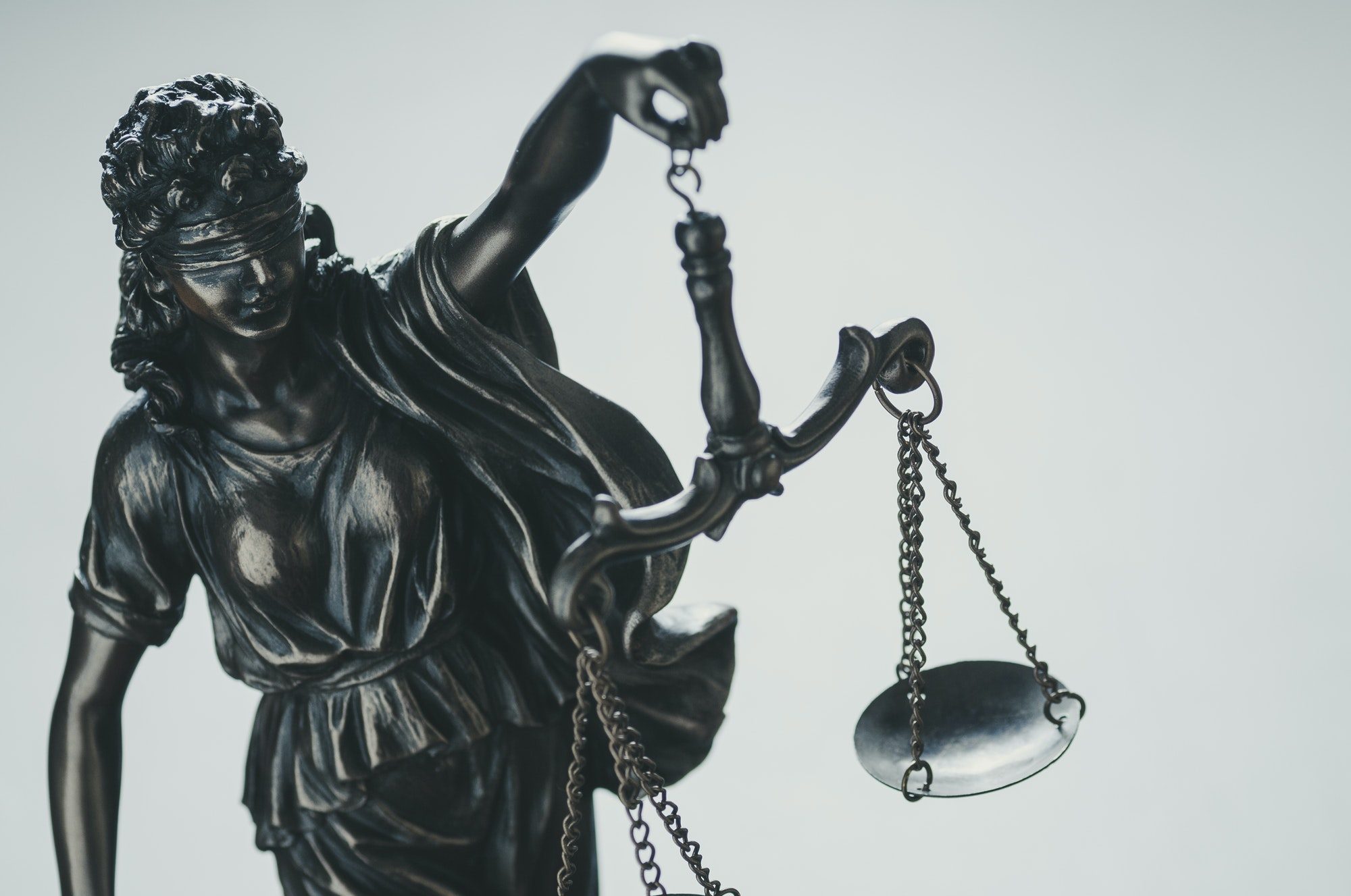 Statue of Justice holding aloft scales